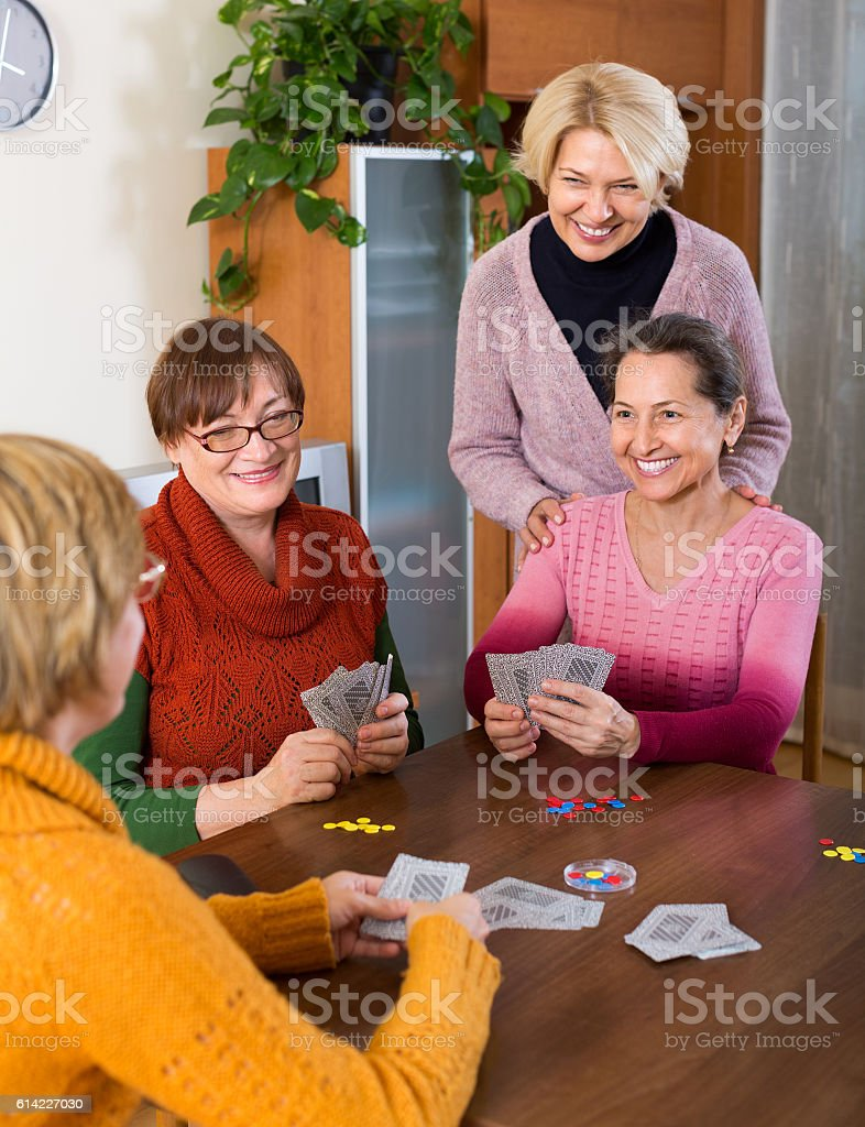 Female pensioners playing cards stock photo