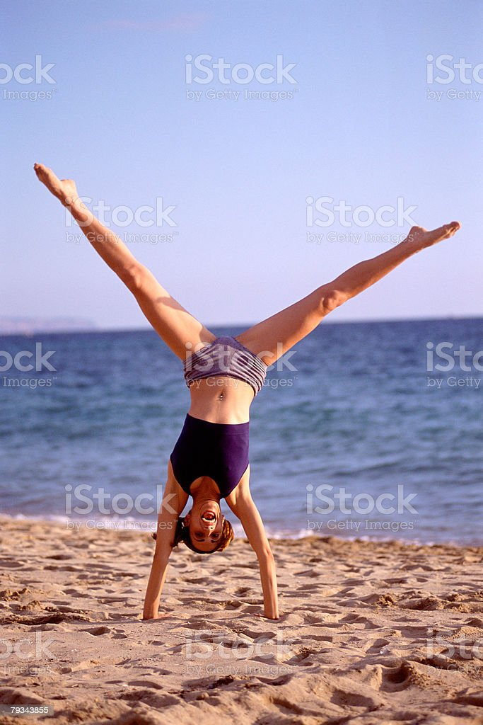 Female performing handstand 免版稅 stock photo