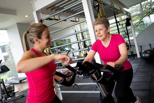 Female Personal Trainer Motivating Her Client On The ...