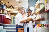 Female pharmacist assisting senior customer