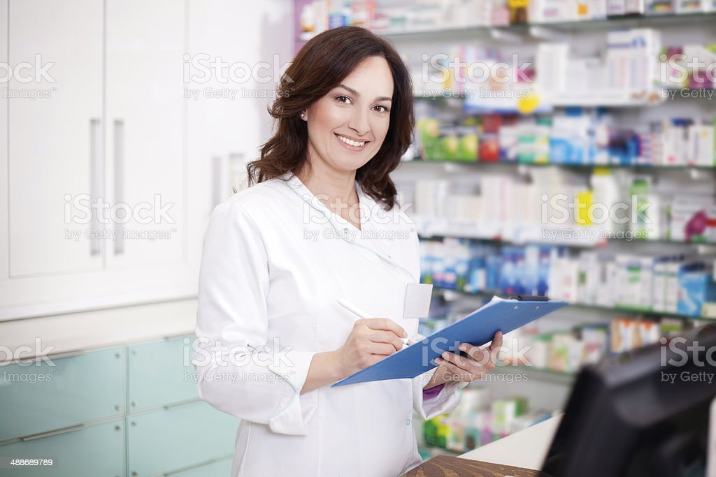 Female pharmacist at medical store royalty-free stock photo