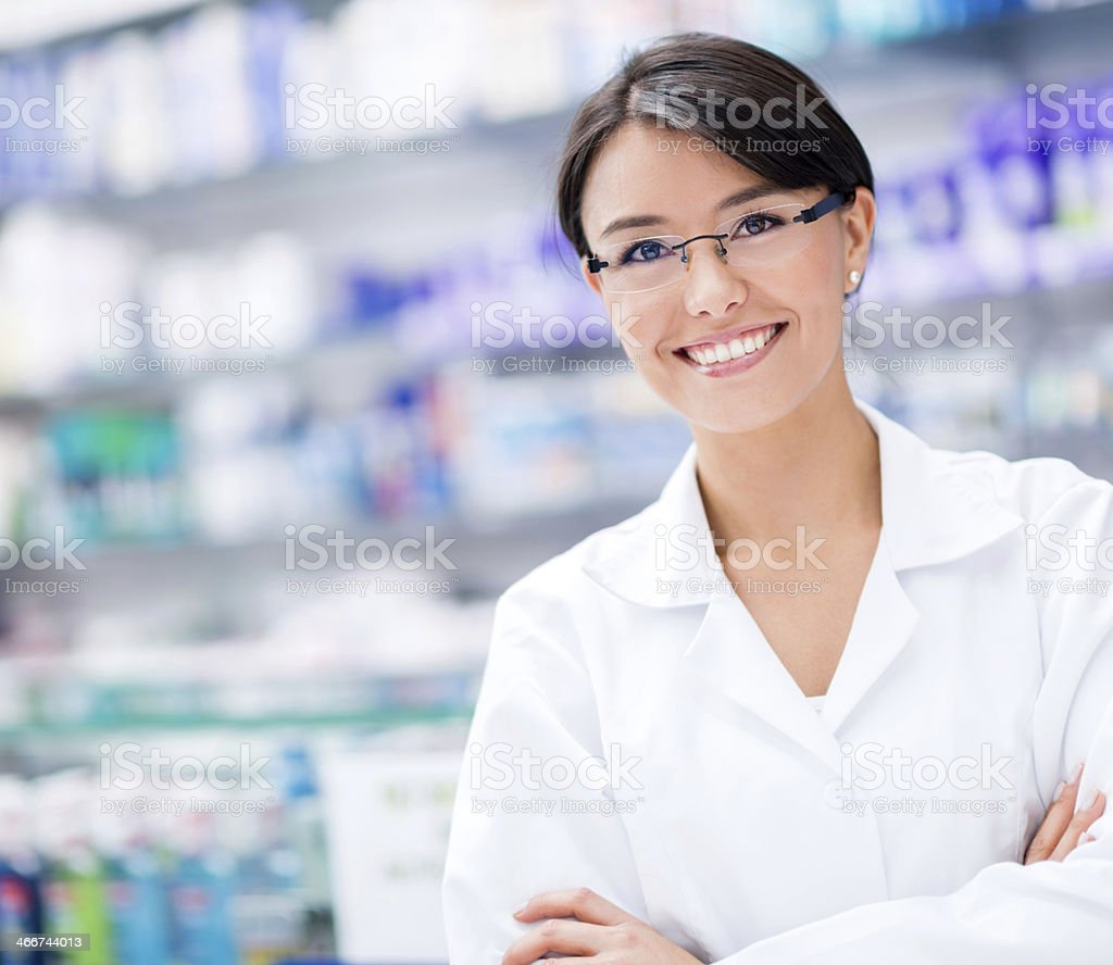 Female pharmacist at the drugstore stock photo