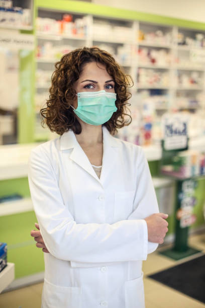 Female pharmacist during the pandemic stock photo