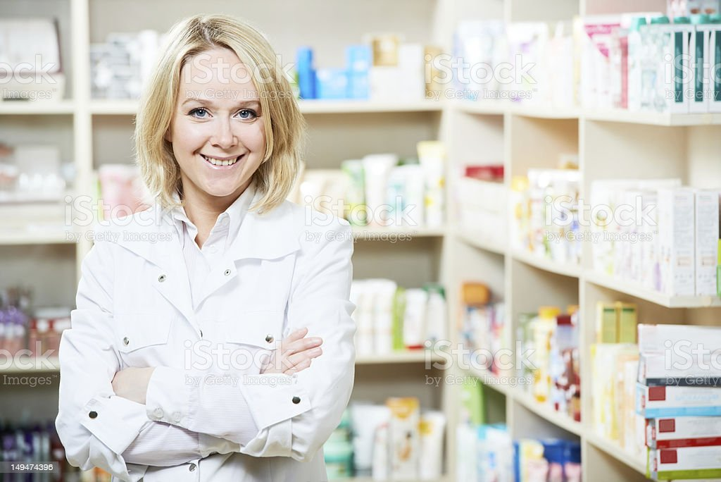 A female pharmacist in a drugstore royalty-free stock photo