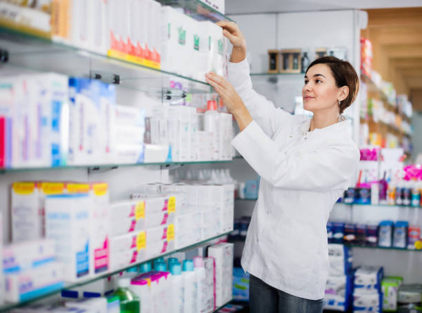 Female pharmacist suggesting useful body care products stock photo
