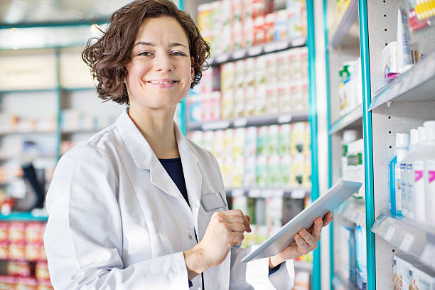 Female pharmacist with a digital tablet stock photo