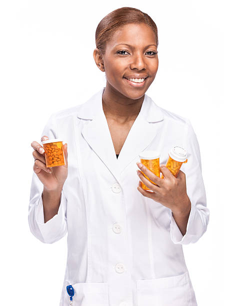 Female Pharmasist with Medicine Bottles stock photo