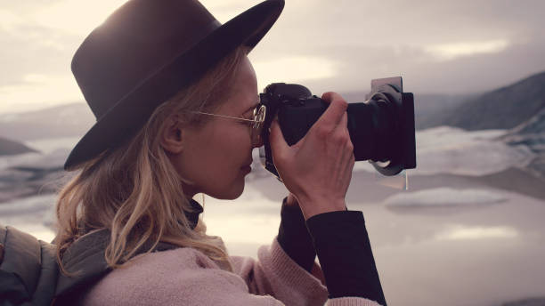Female photographer at glacier lagoon picture id1138361321?b=1&k=6&m=1138361321&s=612x612&w=0&h=d8ooe19trjp b4zphehhtxpwyba3jpqy64eiwvkrnmc=