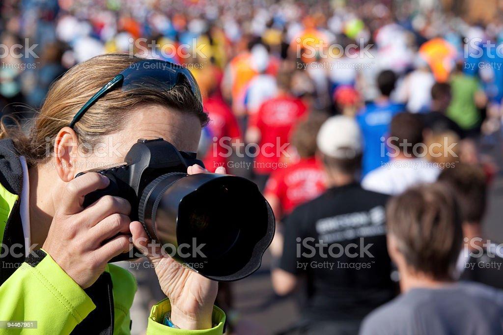 female photographer at marathon stock photo