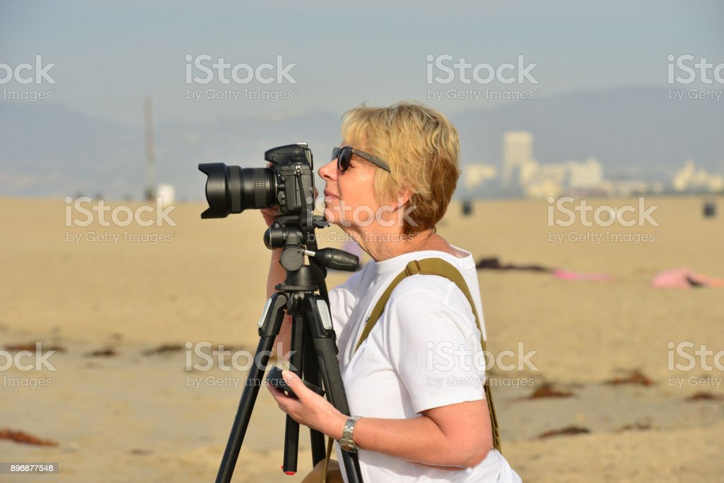 Female photographer at Venice beach in California stock photo