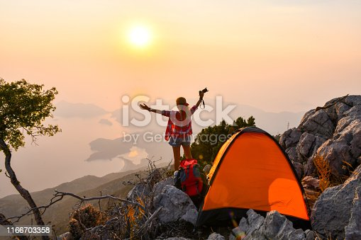 Female photographer camping.