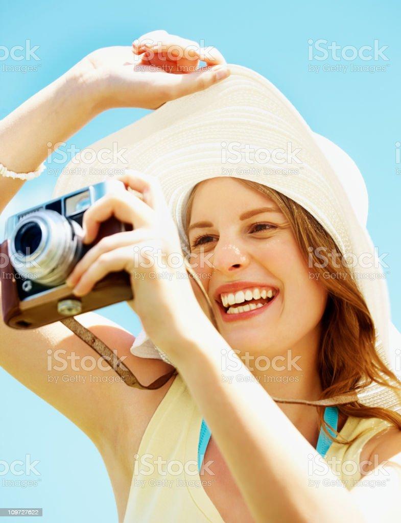 Female photographer holding a camera royalty-free stock photo