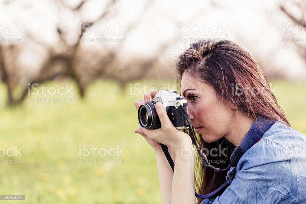 Female photographer in a park royalty-free stock photo