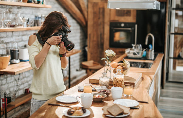 Female photographer taking photos of food at dining table picture id956335258?b=1&k=6&m=956335258&s=612x612&w=0&h=t 2acl0lynshzzhu x2fslpcz8nm0u0dk 53n 724tc=
