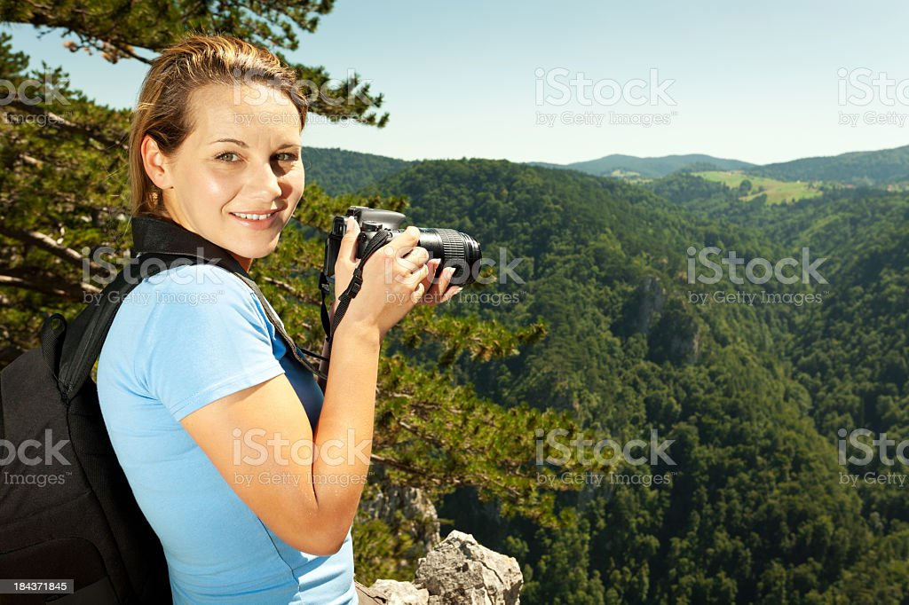 Female photographer taking pictures in nature royalty-free stock photo