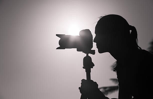 Female photographer taking pictures outdoor stock photo