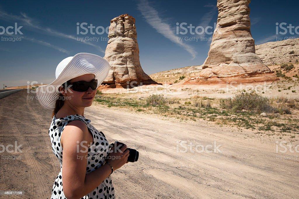 Female photographer taking shot of Elephant Feet stock photo