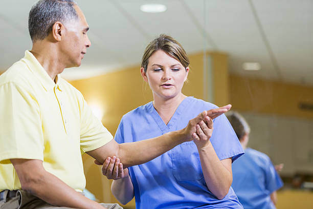 Female physical therapist, African American patient stock photo