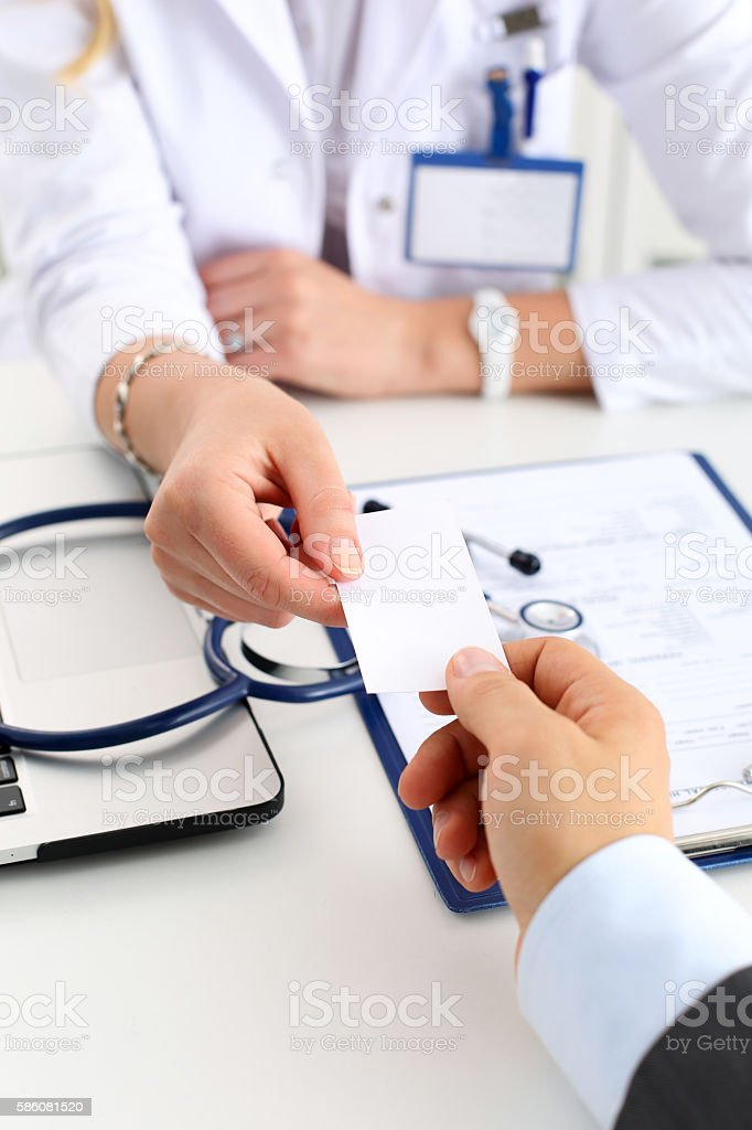 Female physician hand hold white calling card stock photo