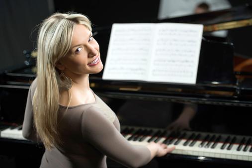 Female pianist turning towards the camera