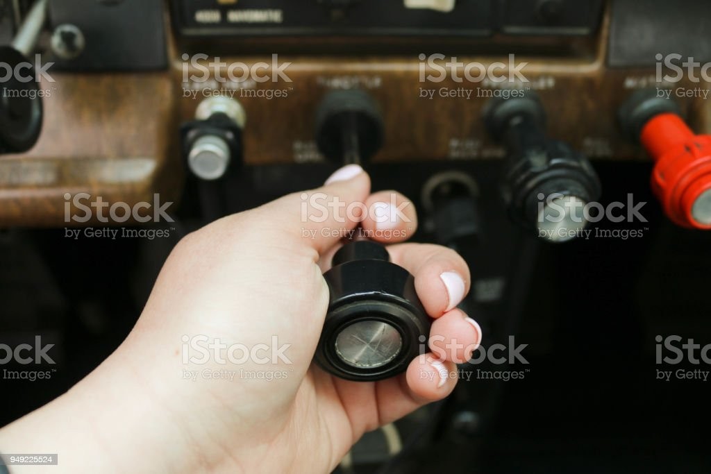 Female pilot hand on controls stock photo