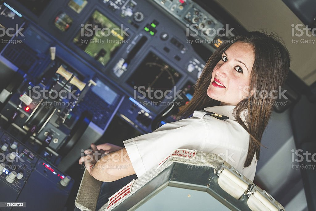 Female Pilot in the Airplane Cockpit stock photo