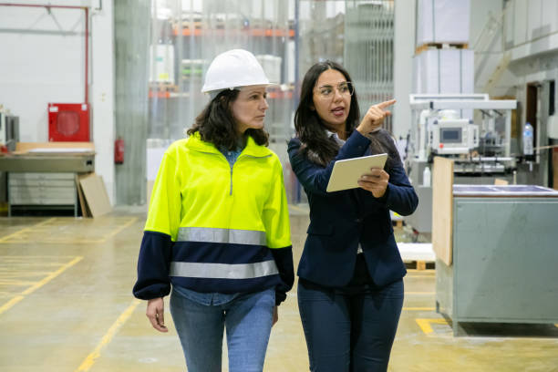 Female plant manager with tablet and inspector stock photo