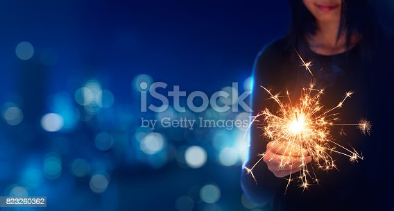 istock Female playing sparklers during celebration 823260362