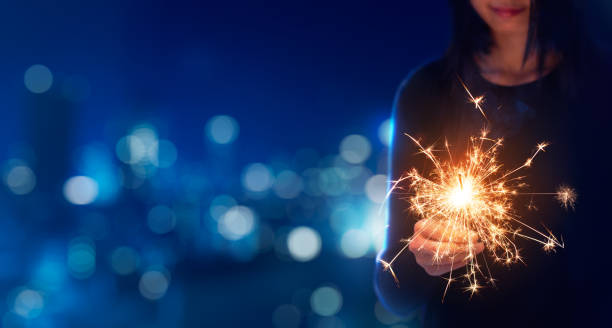 female playing sparklers during celebration - sparkler stock pictures, royalty-free photos & images
