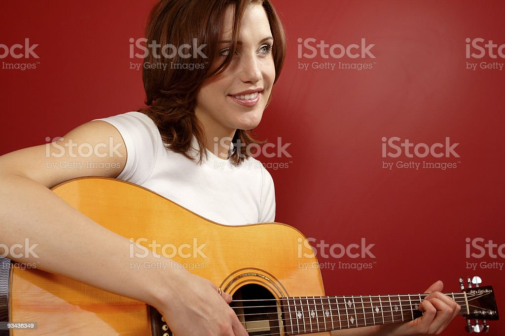 Female playing the guitar royalty-free stock photo