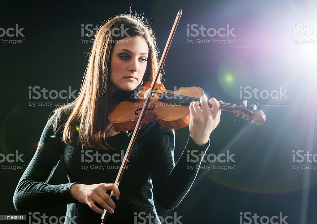 Female playing the violin. stock photo
