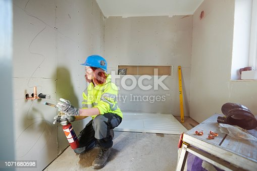 female plumbing trainee