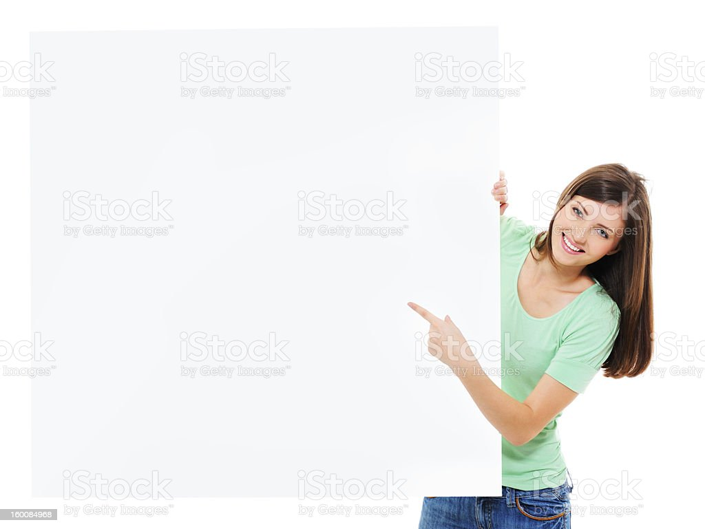 female pointing on blank billboard royalty-free stock photo