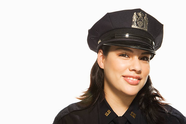 Female Police Officer on white background, portrait Female Police Officer on white background, portrait uniform cap stock pictures, royalty-free photos & images