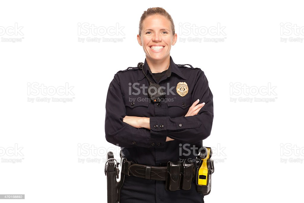 Female police officer with arms crossed stock photo