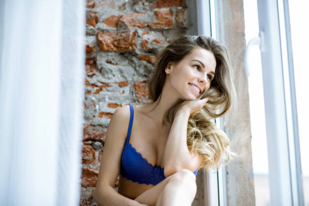 Female portrait of cute lady in black blue indoors stock photo
