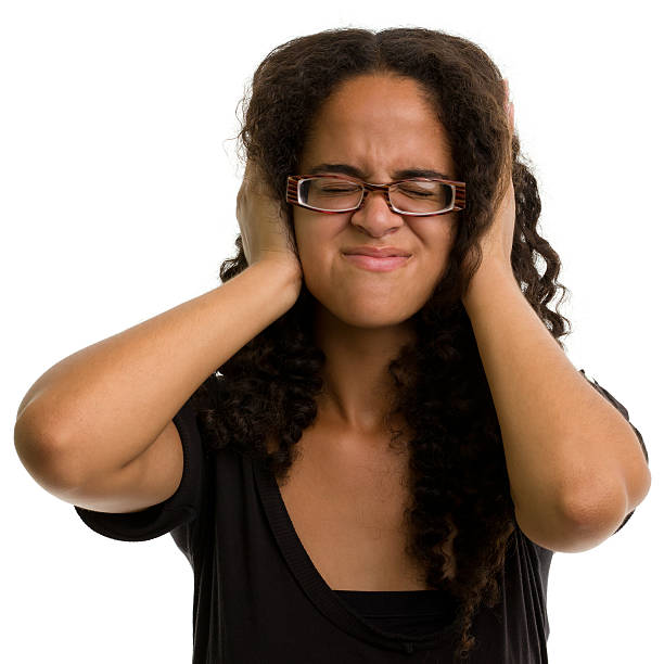 Female Portrait Portrait of a woman on a white background. http://s3.amazonaws.com/drbimages/m/js.jpg hands covering ears hear no evil teenage girls women stock pictures, royalty-free photos & images