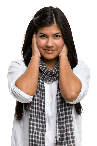 Female Portrait Portrait of a young woman on a white background. http://s3.amazonaws.com/drbimages/m/ja.jpg hands covering ears hear no evil teenage girls women stock pictures, royalty-free photos & images