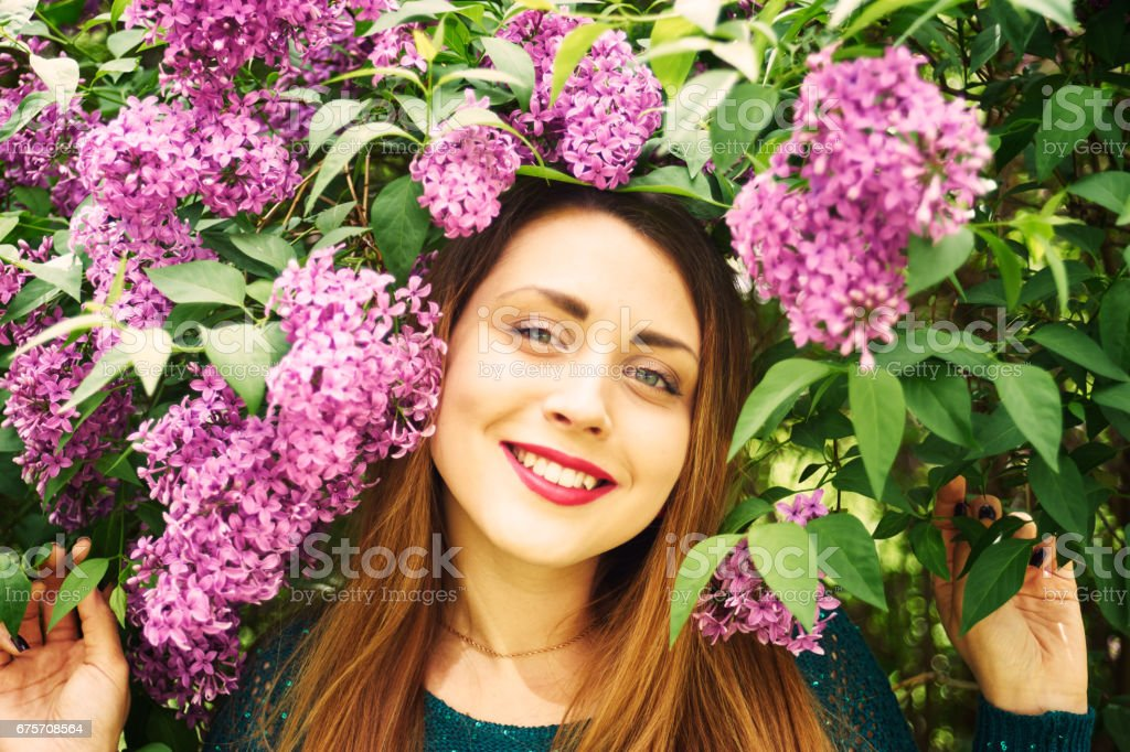 A female portrait with spring blossoming lilac royalty-free stock photo