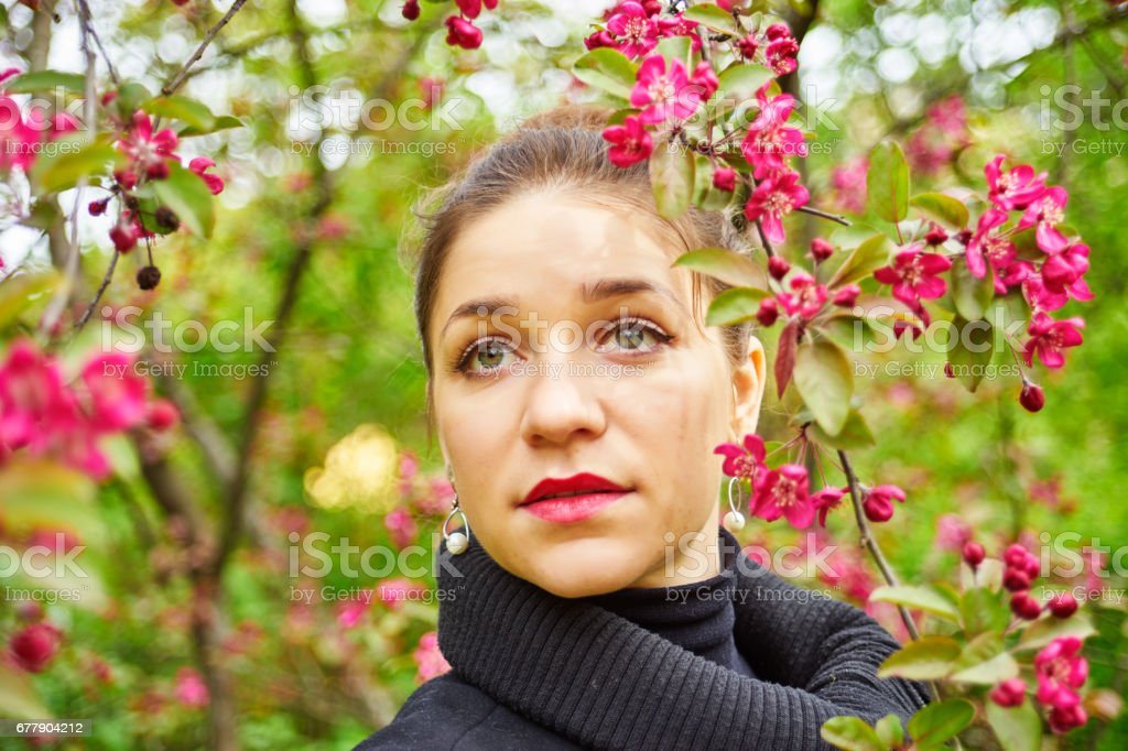 A female portrait with spring blossoming tree royalty-free stock photo