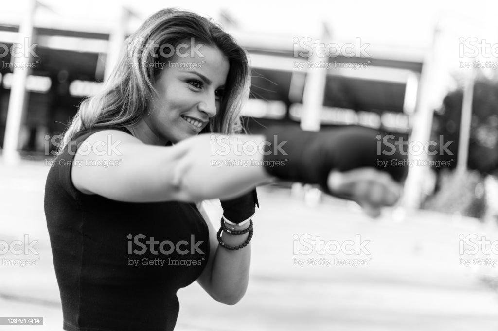 Female posing before boxing training; black and white photo stock photo