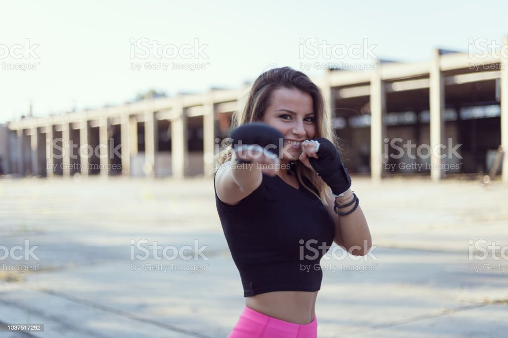 Female posing before boxing training stock photo