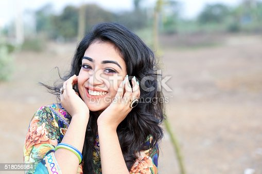 Female Girl model smile happy posing outdoors hand on face crop space