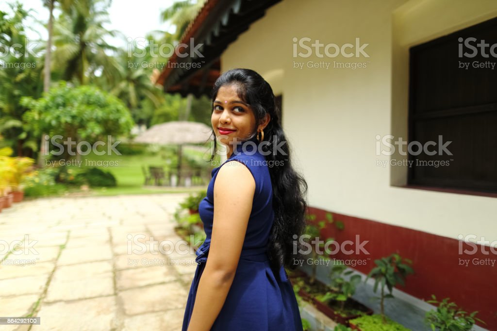 Female Posing in Blue Dress royalty-free stock photo