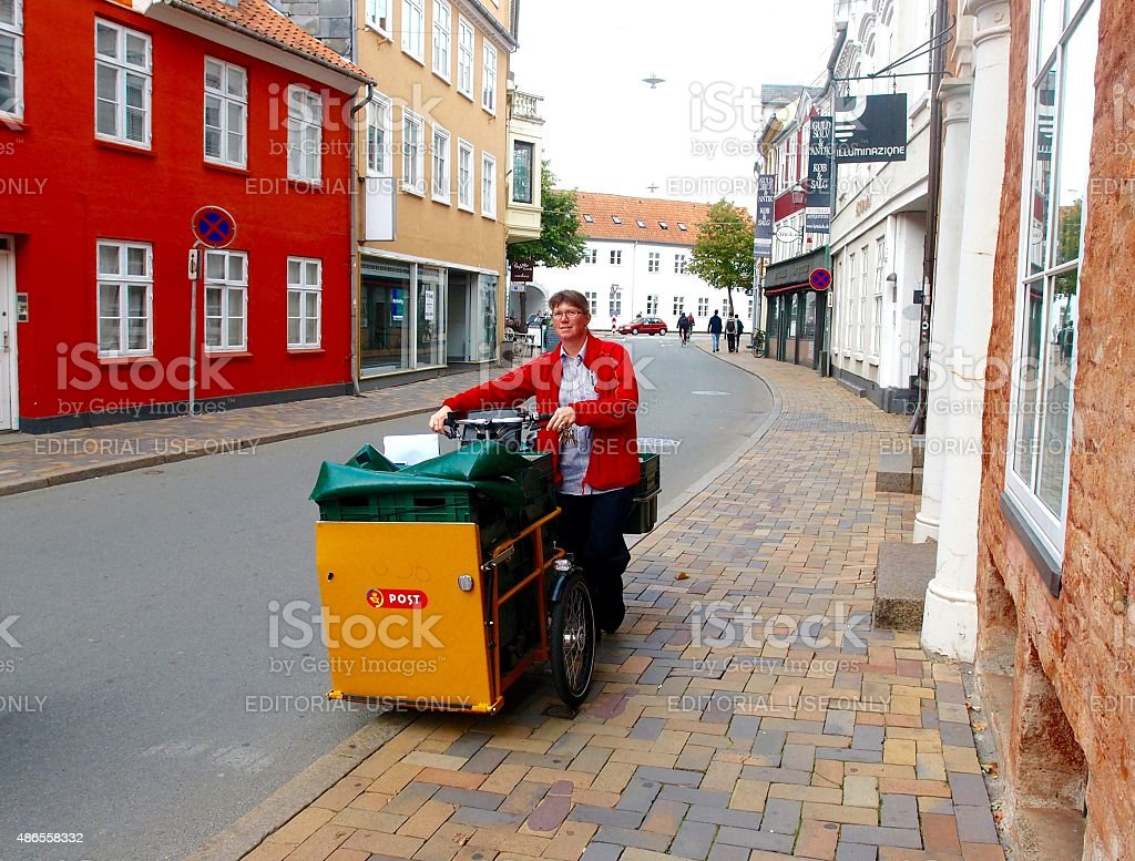 Female Postal Carrier with Bicycle stock photo