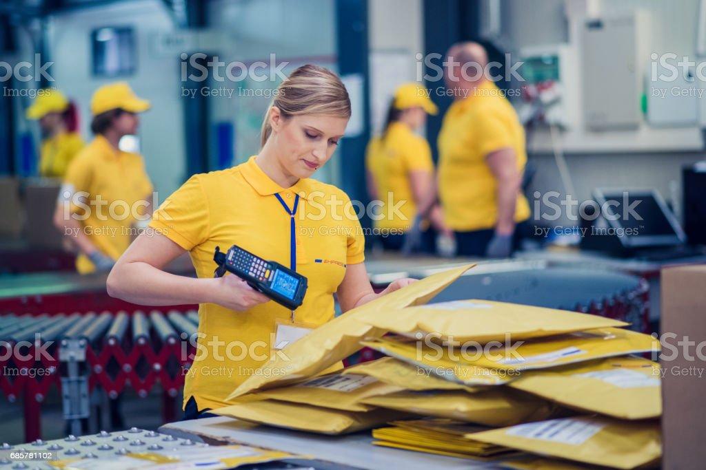Female postal worker stock photo