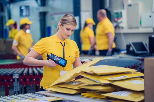 female postal worker - postal worker стоковые фото и изображения