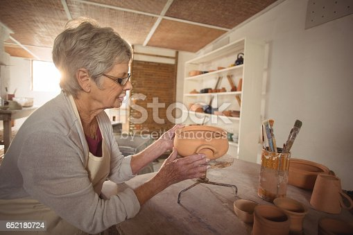 652188430 istock photo Female potter checking bowl 652180724