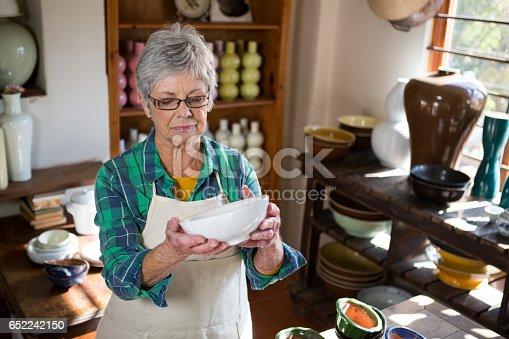 652188430 istock photo Female potter checking bowl 652242150