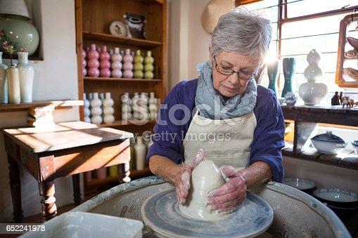 652188430 istock photo Female potter making pot 652241978